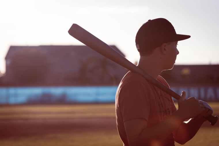 man holding baseball bat